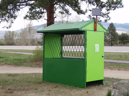 automatic horse feeder with the side doors open